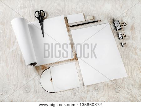Photo of blank stationery set. Blank corporate identity template on light wooden background. Mock-up for your design.