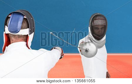 Man wearing fencing suit practicing with sword against digitally generated image of tracks