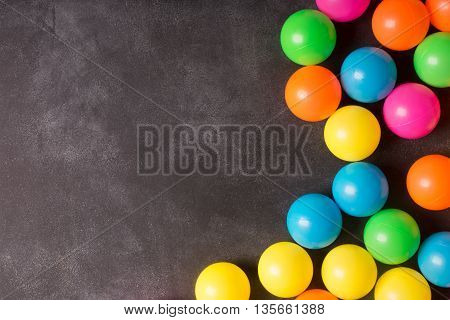 Black chalkboard with copy space and colorfull plastic balls