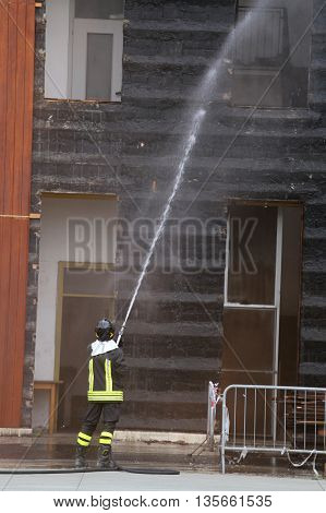 Firefighters Extinguished The Fire In The Building During Practi