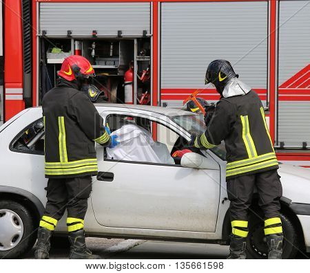Firefighters While Saving The Wounded In The Broken Car