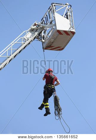 Firefighter Hung The Rope Climbing In The Firehouse