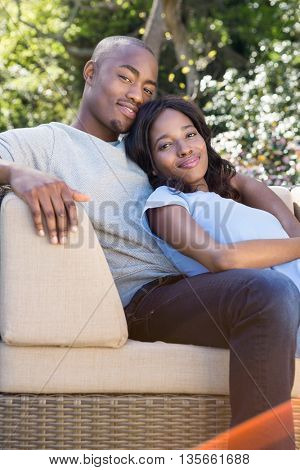 Portrait of young couple relaxing on the sofa in the park