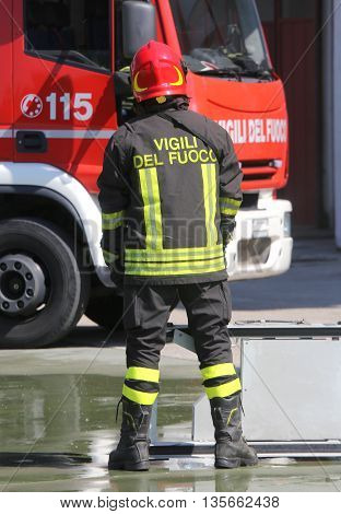 Isolated Italian Fireman With Protective Uniform And Helmet On H
