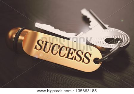 Keys to Success - Golden Keychain over Black Wooden Background. Closeup View, Selective Focus, 3D Render. Toned Image.