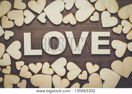 word love made up with wooden letters on the table