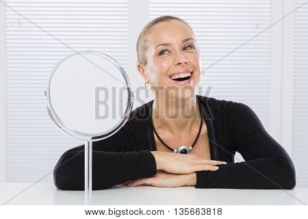 Adult woman and mirror
