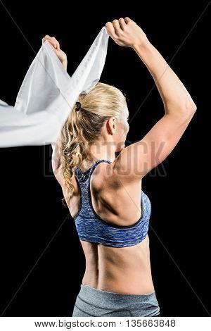 Athlete holding flag on black background