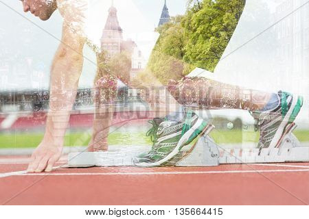Side view of a man ready to race on running trac against canal in amsterdam