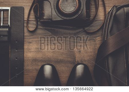 brown shoes, belt, bag and film camera with copy space