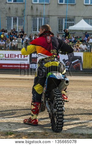 Rivne Ukraine - 11 October 2015: Unknown rider during a prepare for the race at the Open Cup Speedway to the day of the city Rivne