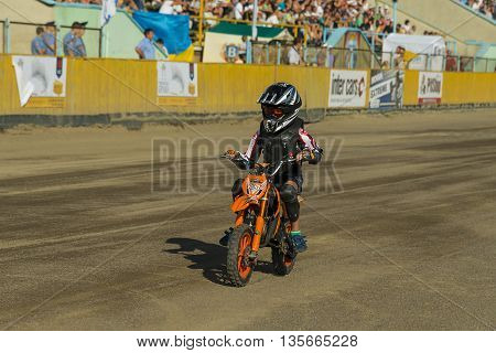 Rivne Ukraine - 11 October 2015: Young rider overcomes the track during the opening the Open Cup Speedway to the day of the city Rivne
