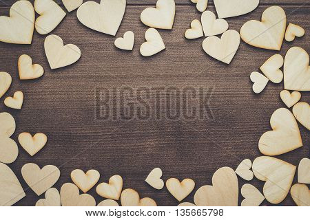 wooden heart shapes on the brown table