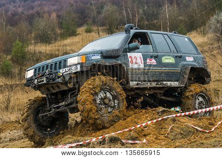 Lviv Ukraine - February 21 2016: Off-road vehicle brand Jeep Cherokee overcomes the track on a amateur competitions Trial near the city Lviv Ukraine.