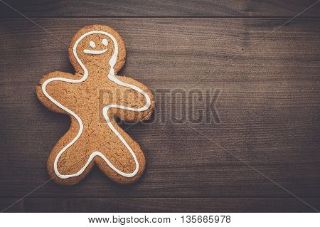 gingerbread man cookie on the wooden background