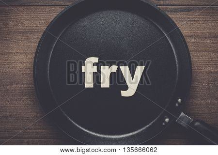 big pan on the table with word fry