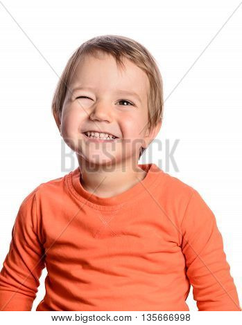 Cute winking child on a white background