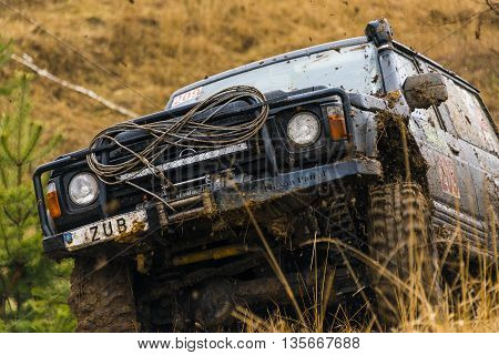 Lviv Ukraine - February 21 2016: Off-road vehicle brand Nissan overcomes the track on a polygon near the city Lviv Ukraine