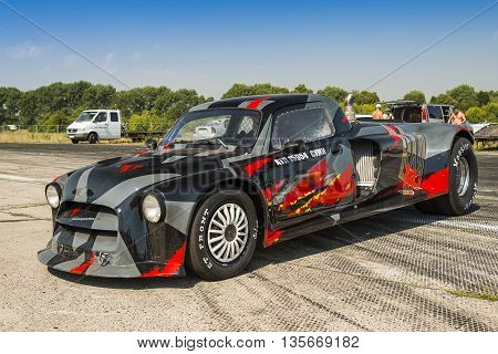 VinnytsiaUkraine-July 26 2015: Drag racing car prepares in a park-service before the races of the Drag championship of Ukraine on July 262015 in Vinnytsia Ukraine.