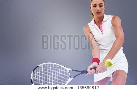 Athlete playing tennis with a racket against grey vignette