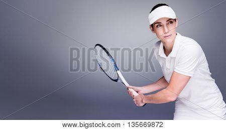 Female athlete playing tennis against grey vignette
