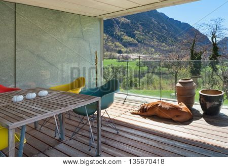 Terrace of a modern mountain house, panoramic view