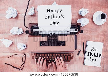 Hands typing on typewriter happy fathers day