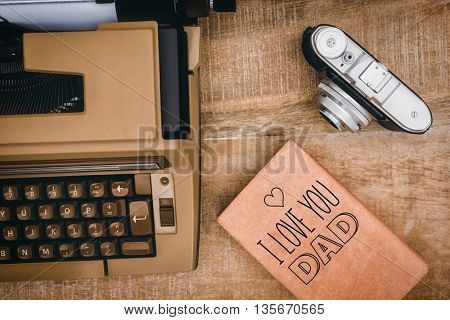 fathers day greeting against view of an old typewriter and camera