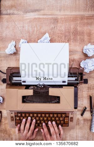 Hands using typewriter with my hero message