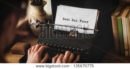 Man writing best dad ever on typewriter