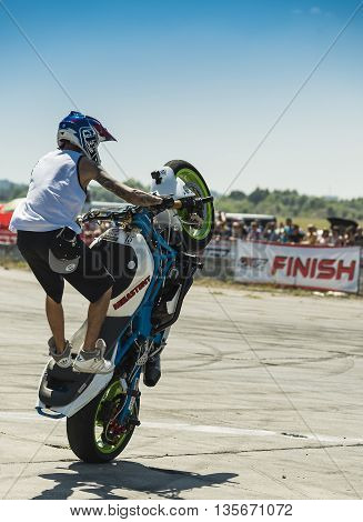 Vinnytsia Ukraine-July 25 2015: Unknown stunt biker entertain the audience before the start of the championship of drifting on July 252015 in Vinnytsia Ukraine.
