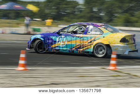 Vinnytsia Ukraine-July 25 2015: Rider Vladimir Nikiforov on the car brand BMW overcomes the track in the Drift championship of Ukraine on July 252015 in Vinnytsia Ukraine.