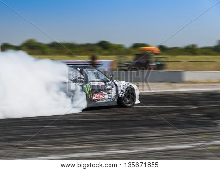 Vinnytsia Ukraine-July 25 2015: Rider Dmytro Illyuk on the car brand Nissan overcomes the track in the Drift championship of Ukraine on July 252015 in Vinnytsia Ukraine.