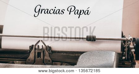 Gracias papa written on paper with typewriter