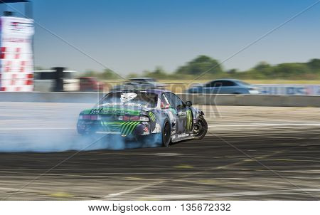 Vinnytsia Ukraine-July 24 2015: Unknown rider on the car brand Nissan overcomes the track in the Drift championship of Ukraine on July 242015 in Vinnytsia Ukraine.