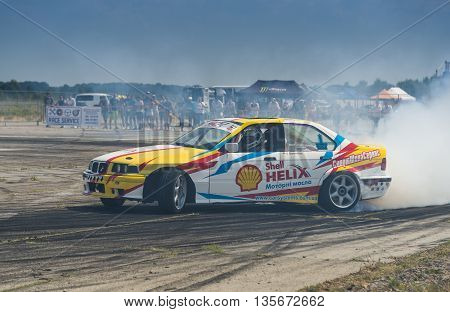 Vinnytsia Ukraine-July 24 2015: Rider V. Borovitsky on the car brand BMW overcomes the track in the Drift championship of Ukraine on July 242015 in Vinnytsia Ukraine.
