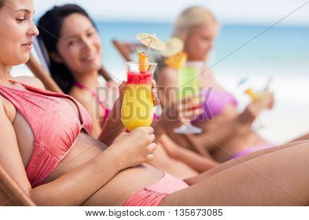 Friends enjoying a cocktail at the beach