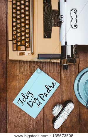 Feliz dia del padre written on paper with typewriter