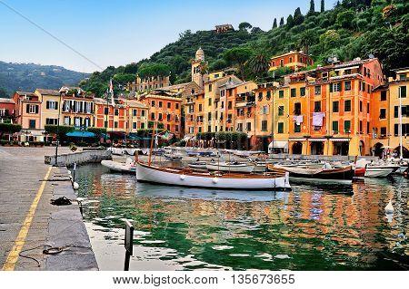 Portofino pier with boats and the central square Piazzetta in Liguria, Italy