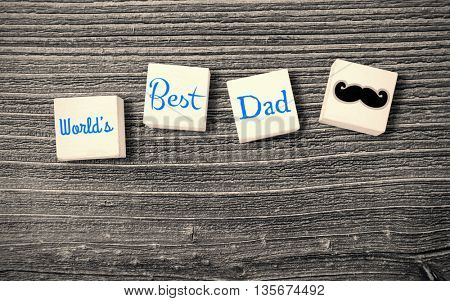composite image for fathers day in a parquet background