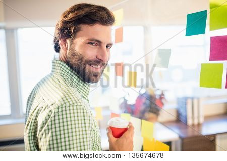 Casual businessman smiling in office