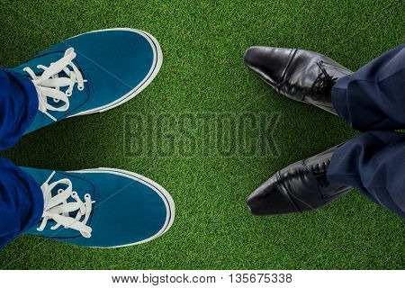 Businessman standing isolated on white background against close up view of astro turf