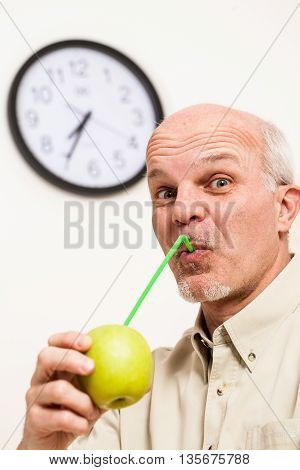Bearded Mature Man Sipping Juice From Apple