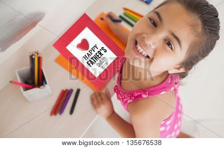 fathers day greeting against young girl drawing on orange paper