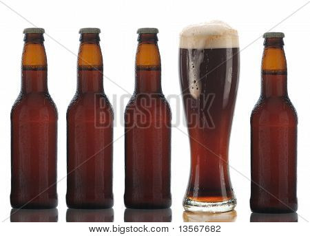 Four Brown Beer Bottles And Full Glass