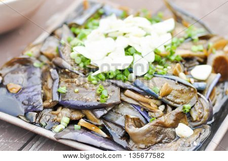 stir-fried eggplant dish with green onion on the table