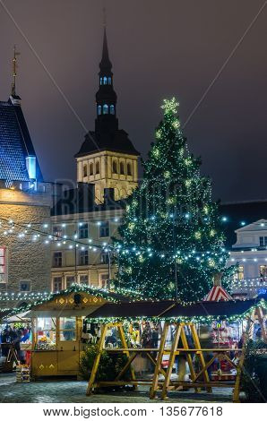 TALLINN ESTONIA -JANUARY 05: People enjoy Christmas market in Tallinn on January 05 2014 in Tallinn Estonia. It is Estonia oldest Christmas Market with a very long history dating back to 1441.
