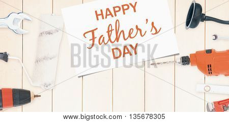 Happy fathers day message written on paper next to tools