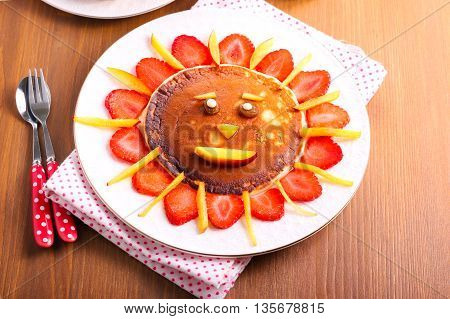 Pancake with strawberry and fruit for kids