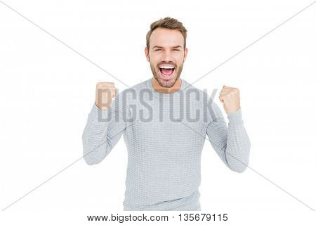 Portrait of a happy young man smiling at camera on white background